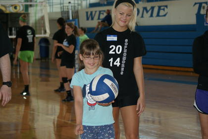 Lady Hawk Gracen Williams offered advice to camper Samantha Perkins at the volleyball clinic.
