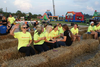 Several volunteers took a break and listened to J.D. Shelburne perform.