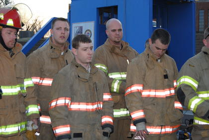 Members of Buffalo and LaRue County fire departments listen to instruction on how the course should be ran. 