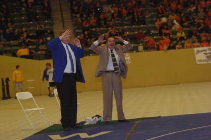 Mat Hawk coaches Eddie Paden, assistant, left, and Gary Canter react to a match at the State Wrestling Tournament.
