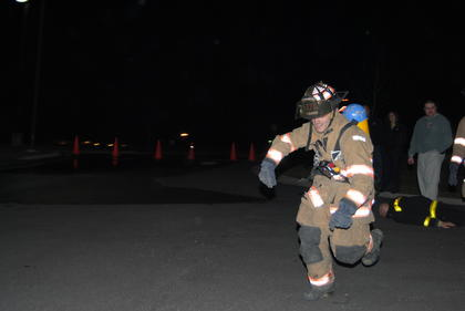 LaRue County firefighter, Eric Clark, runs to the next station.