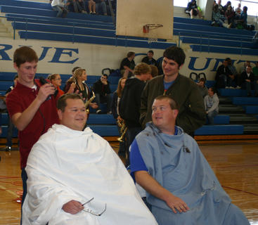 LCHS Marching Band members Kyle Hyatt, with clippers, and Sean Wathen took turns giving Jaime Smith and Michael Collins a buzzcut. The high school honored the band and directors Nov. 3.