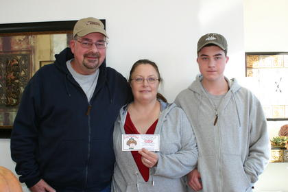 Daryl, Lisa and Jacob Pullin, winners from Save-A-Lot 