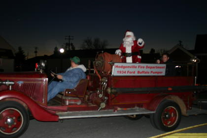 Santa rode in the City's vintage fire truck to the Civic center to visit with children.