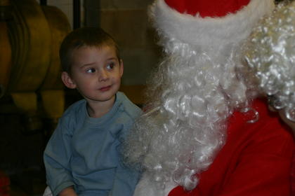 Ryan Jewell gave Santa the eye as the Jolly Old Elf asked what type of presents hed like for Christmas. Santa and Mrs. Claus visited with about 70 children at Magnolia Firehouse onChristmas Eve before moving on to  Buffalo and Hodgenville.