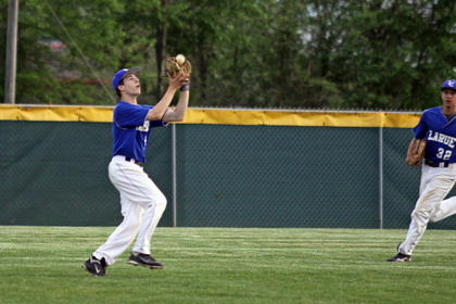 8th grader Brock Robinson makes the catch as FR. Chandler Lynn looks on.