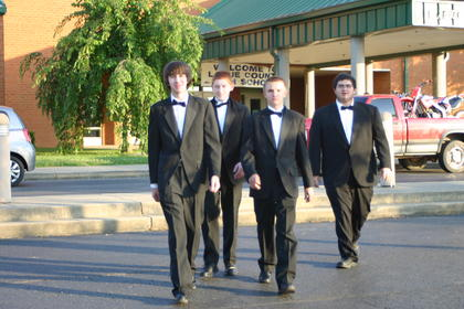 Jesse Highbaugh, Zachary Thurman, John Michael Oller and Joey Gearon, members of the Band of Hawks, walked to the gym to play for commencement ceremonies.