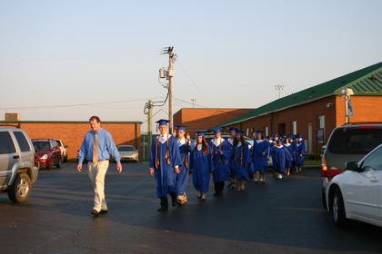 Senior sponsor Rex Hanson led the seniors to the gym before commencement. In front is valedictorian Zachary Lee and salutatorian John Slack.