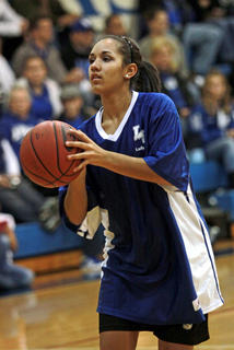 Lady Hawk Alexis Brewer put up a shot at Blue/White Night.