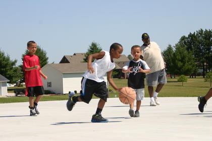 Coaches Paul Hanley and Casey Gooden's Next Level Basketball Academy kicked off this year at Hanley's house. About 30 pre-high school children of all ages participated in fundamental drills and full-court games during the three-day camp.