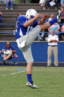 Koy Lindsey punted the football.