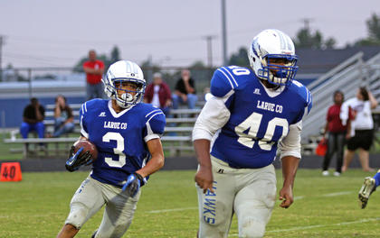 Marquis 'Tootie' Franklin, in back, looked to Damarcus McCray to block as he ran with the football during Friday's scrimmage with Breckinridge County.