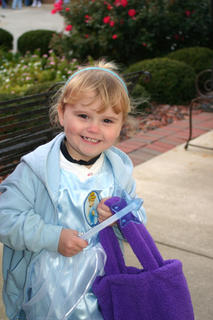 Three-year-old Elizabeth Dye trick-or-treated at Blazin' Expressions booth.