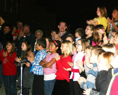 Children applauded as the Christmas tree on Lincoln Square was lit.
