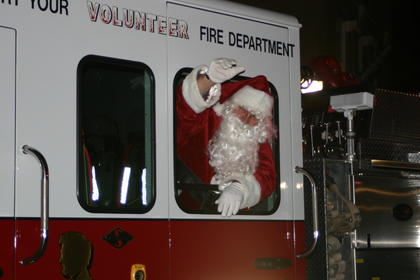 Santa waved to the crowd from a fire truck as it drove around Lincoln Square.