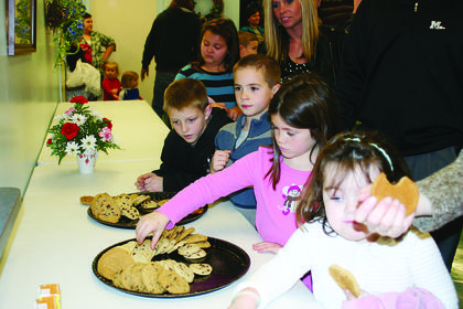 Families enjoyed cookies at Hodgenville City Hall after visiting with Santa.