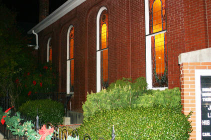 Lights glowed in the stained glass windows of Hodgenville Christian Church.