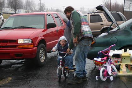 Kile Jewell tried to convince his son, Nicholas, 2, to let him load his new bicycle in the family's car.