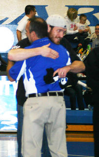 Retiring coach Gary Canter gets a hug from Todd Allen.