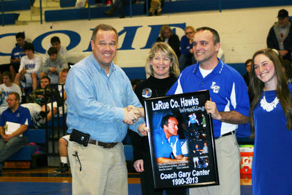 LCHS Principal Paul Mullins congratulates Gary and D.J. Canter. Daughter Hannah is at right.