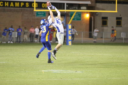 Senior Michael Neal held on to a pass during the Hawks' loss to Washington County.