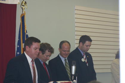 Rev. David Webb, pastor at Hodgenville Pentecostal Church, at left, led the invocation before the meal at Tuesday's Lincoln Dinner. From his left are U.S. Sen. Rand Paul, U.S. Rep. Brett Guthrie and state representative Michael Meredith.
