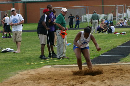 "LaRue County's Shaila Winston competed in the long jump at the May 10 conference meet. At left, track official Jack Mitchell, former LaRue Coach James ""Boo"" Brewer and John Hardin track coach Ralph Tucker check the distance."
