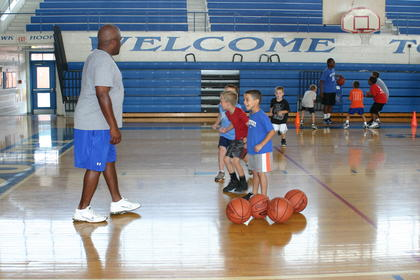 Simon Ford worked with elementary students in the Future Hawks Basketball Camp Monday. Gavin Ferguson and Caden Davis appeared energetic for the session.