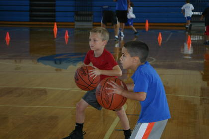 Caden Davis, left, and Gavin Ferguson practiced passing the ball.