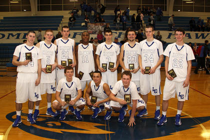 The LaRue County Hawks were presented plaques after winning the National Guard Holiday Classic. Front from left, Dalton Metcalf, Marquis Franklin, Chase Watson; back, Michael Neal, Dustin Coulter, Tyler Howell, Kelton Ford, Thomas Harman, Kody Key-Close, Caleb Sheffer and Micah Wiseman.