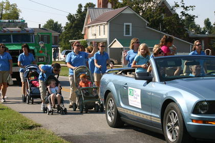 Employees of Cecilian Bank and their children walked in the parade.