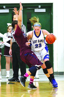 LaRue County's Ivy Brown pushes past Marion County's Makayla Epps in the 5th Region finals.