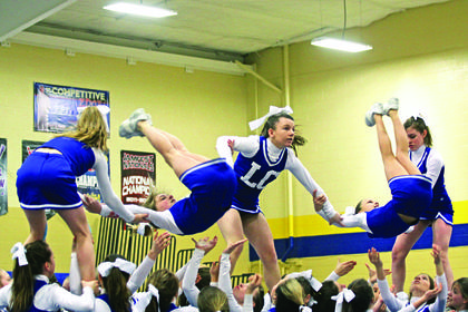LCMS cheerleaders Trinity Perkins, Madison Eads, Kaylee Hornback, Destiny Kirby and Emma Bowling show off their airborne skills.