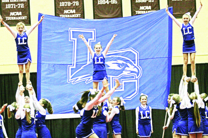 Flyers Madison Eads, Christina Hardin and Destiny Kirby balance on the shoulders of their stunt groups.