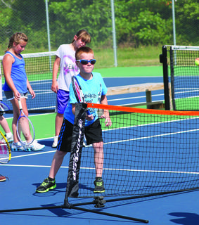Luke Howell prepares his swing for his technical practice at Tennis Camp.
