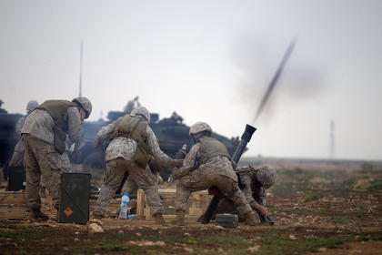 Marines practice their team work while firing mortars in southern Morocco. African Lion is an exercise between the Kingdom of Morocco and the U.S. that involves more than 2,000 U.S. service members and approximately 900 members of the Royal Moroccan Armed Forces.