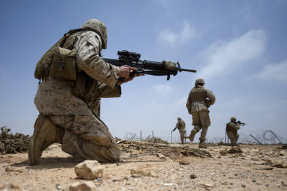 A group of Marines work on their squad movement skills during African Lion 2011. During the exercise U.S. and Moroccan forces trained on different types of military training including command post, live fire, peacekeeping operations, disaster response, aerial refueling and low-level flight training. 