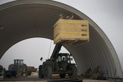 Navy Seabees use a forklift to get to hard-to-reach places while building a hard shelter at the Cap Draa training area in southern Morocco. The shelter will be used for future African Lion exercises. African Lion is an exercise between the Kingdom of Morocco and the U.S. that involves more than 2,000 U.S. service members and approximately 900 members of the Royal Moroccan Armed Forces. 