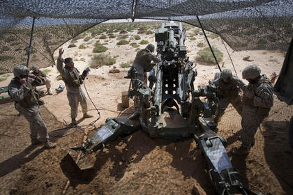 A team of Marines prepares to fire an M777 howitzer during African Lion 2011.