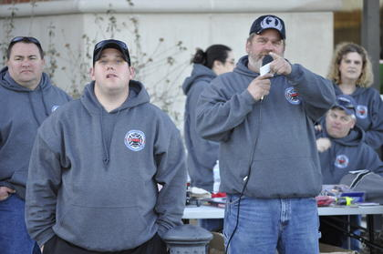 Left, Dale Dobson, Safety Coordinator for the Kentucky Department of Agriculture and LaRue County firefighter calls out door prizes. Fellow LaRue County firefighter Shane Carpenter is at left.