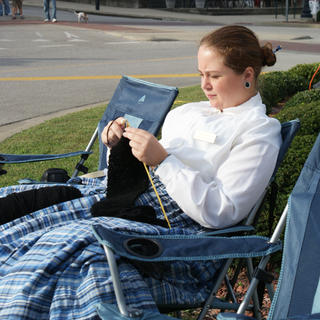 Ashley Ulinkski brought her knitting to Lincoln Days. She portrayed Emily Helm, half-sister of Mary Todd Lincoln, on one of the floats in the parade.