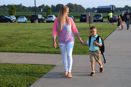 Hunter Caven walks nervously to class holding Bethany Gusler's hand.