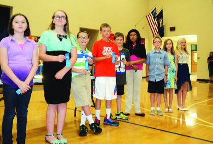 Abraham Lincoln Elementary School students have been selected for the Duke Talent Identification Program (TIP). To qualify, students must score in the top 96 percent of a nationally recognized standardized test and be in the fourth, fifth, or sixth grade. Fifth-graders selected are from left, Zoe Puckett, Adara Dobson, Alex Matherly, Evan Morris, Brandon Perkins, Brittany Serrano join second year students Biven Turner, Amadee Fields, and Katelyn Eads.