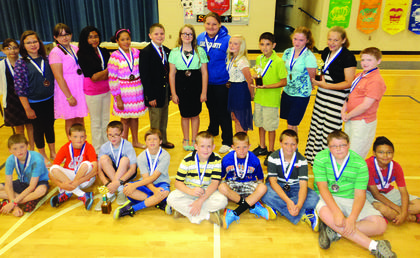 Several fifth-grade students at Abraham Lincoln Elementary School achieved 100 or more math objectives for the school year. Front from left, Noah Cundiff, Evan Morris, Biven Turner, Layne Gribbins, Gavin Whitehouse, Brooks Brackett, Tristen Locke, Dalton Milliken and Jorge Morales; back, Mary Pruitt, Madison Wilmoth, Aimee Hornback, Brittany Serrano, Haley Ferguson, Isaiah Pruitt, Adara Dobson, Zoe VanRiper, Katelyn Eads, Keaton Knox, Rachel Cundiff, Haley Thompson and Ryan Stillwell. In all, the fifth-grade class of 76 students achieved 5,823 objectives this year under the direction of math teacher Karlotta Cecil. Biven Turner was recognized by Cecil for achieving the most objectives for the school year and also setting a new school record of 311 objectives. Haley Thompson was also recognized for placing second for the school year with 212 objectives; Keaton Knox placed third with 205 objectives.