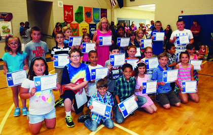 ALES students in kindergarten through fourth-grade with perfect attendance are front from left, Keelin Fisher, Ricky Locke, Elizabeth Wiley, Jacob Hinton, Lacey Cecil; middle, Hannah Despain, Alex Loyall, Dominick Robles, Alex Poore, Jagger McBride, Abi Lester, Richard Morales, Brenna Southwood; back, Larkin Morgan, Luke Howell, Tanner Skaggs, Jackson Riddle, Kayla Thompson, Savannah Jones, Macy Stillwell, Keelin Plouvier, Kayla Maupin, Connor Nicholas and Elam Stillwell.