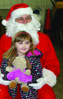 Alina Kilfoile visited with Santa (Tom Smith).