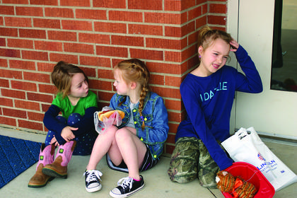 Zoe Cruse, Scout McCurry and Jaden Cruse talked and laughed outside the LaRue County High School gym during the Extension Expo.