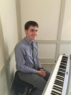 Andrew Coy, recent LCHS graduate and winner of the Hodgenville Woman's Club Scholarship provided musical entertainment featuring 50s music.