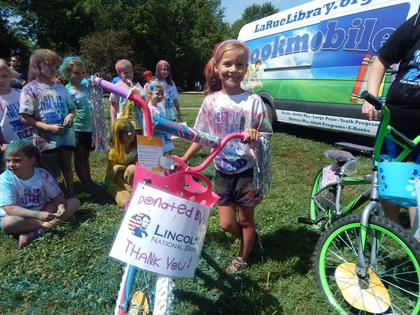 Ariell Butler of Upton won a bike donated by Lincoln National Bank.