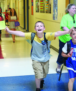 Ashlin Bailey raced down the halls of Hodgenville Elementary after class was dismissed, on his last day of school.